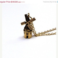 ON SALE Small gold plated pewter Windmill by chrysdesignsjewelry