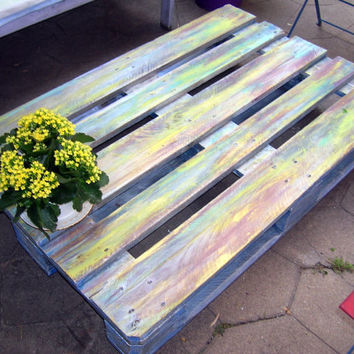 Table low end of a recycled pallet hand painted