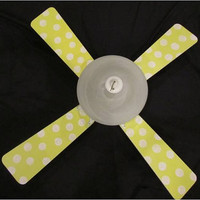 Monkeydots is a one-of-a-kind, upcycled ceiling fan with painted, reversable blades.