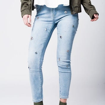 Light wash jeans with floral rhinestones and strass