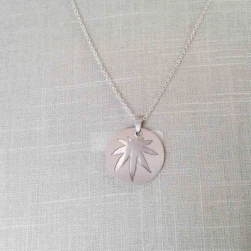 Stainless Steel Cut-Out Pot Leaf Pendant