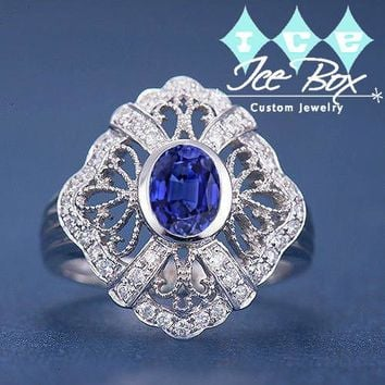 Kashmir Sapphire Engagement Ring 5x7mm Oval Cut Cultured Blue Sapphire set in a 14k White Gold Diamond Filigree Halo Setting