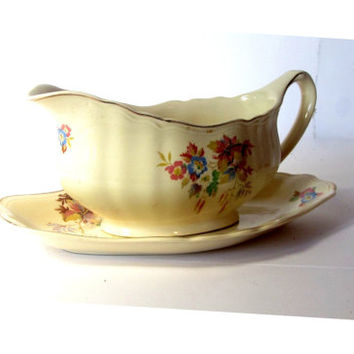 Mid century j&g meakin gravy boat with a rhombus shaped saucer. Yellow floral gold trim sauce bowl. Sunshine series. Made in England.