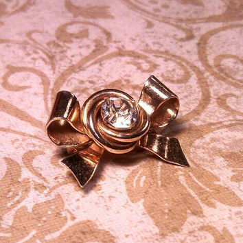 Gold tone bow pin brooch with clear stone Coro