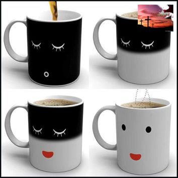 Coffee Mug - It changes colors with hot water.  So cute the faces