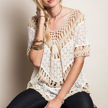 This cute bohemian top features a beautiful semi sheer knit crochet insert tiered lace panel construction, knit crochet v-neckline, short sleeves insert with knit crochet. Unlined. Pair with skinny jeans and sandals.