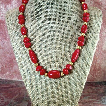 Bright red and gold tone beaded necklace and coordinating pierced earrings.