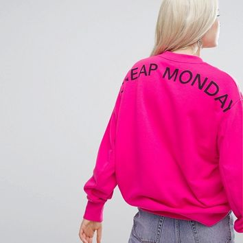 Cheap Monday Oversized Sweatshirt with Back Logo in Pink at asos.com