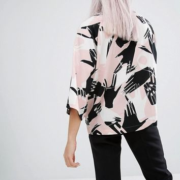 Monki Hand Print Fluted Sleeve Top at asos.com