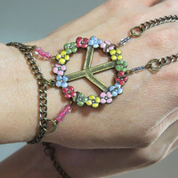 "Rainbow Peace ""Slave Bracelet"" Ring. Glittery colorful Flower Peace Sign Charm. Colorfully beaded Adjustable Bracelet. Fits wrists 6 to 8 in"