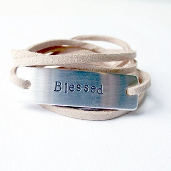 Beige soft suede tie wrap faith quote bracelet stamped blessed aluminum metal tag.