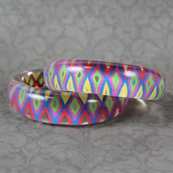 Pair of Vintage Clear Lucite Painted Bright Geometric Cuff Bracelets