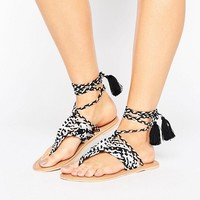 ASOS FOSSIL Leather Tie Leg Flat Sandals at asos.com