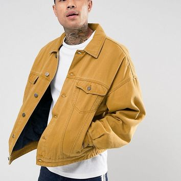 ASOS Oversized Denim Jacket with Padding in Mustard at asos.com