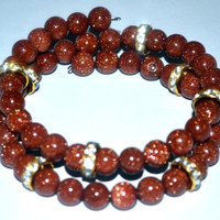 Memory Wire Bracelet With Sparkling Goldstone Beads Paired With Clear Rondell Sparkles