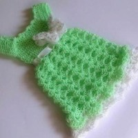 Knit green baby dress with detailed white butterfly