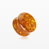 A Pair of Amber Splash Double Flared Ear Gauge Plug