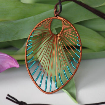 Leaf shaped copper wire wrapped turquoise necklace pendant with small shiny turquoise beads. Wire wrapped pendant.