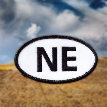 "Nebraska NE Patch - Iron or Sew On - 2"" x 3.5"" - Embroidered Oval Appliqué - Cornhusker State - Black White Hat Bag Accessory Handmade USA"
