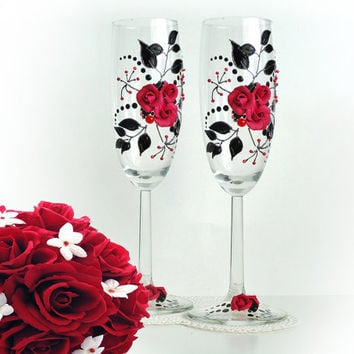 Beautiful hand decorated wedding or anniversary champagne glasses, elegant toasting flutes with beads and roses