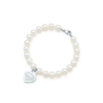 Tiffany & Co. -  Return to Tiffany™ small heart tag in silver on a freshwater pearl bracelet.