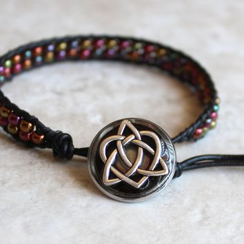 Metallic, multi-colored bracelet with Celtic knot button closure