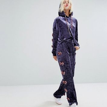 Lazy Oaf Cropped Velvet Hoodie With Bow Sleeve Detail In Luxe Velvet Co-Ord at asos.com