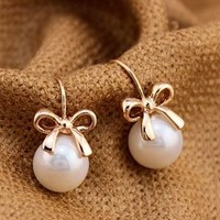 Golden Bow And Pearl Fashion Earrings