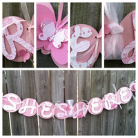 Baby shower banner: she's here, pink and white baby girl banner
