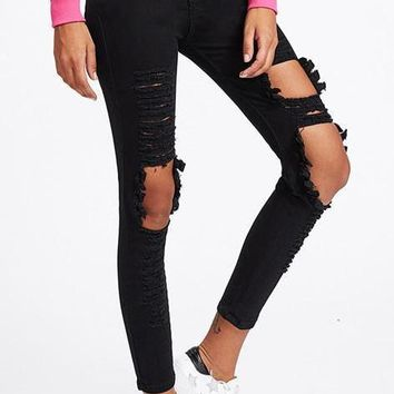 Women's Ripped Black Skinny Jeans