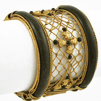 "30% off use promo code ""wanelo"" at checkout. Gilded Cage Black and Gold Cuff Bracelet"