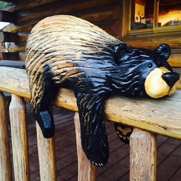 Chainsaw carved rail bear