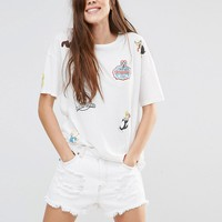 Pull&Bear Tshirt With Looney Tunes Badges at asos.com