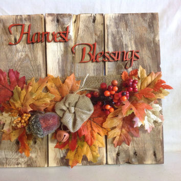 Harvest Blessings Fall Wall Decor Made from repurposed pallet wood, Lasered letters, and  Fall foliage, burlap bow, and orange bell.