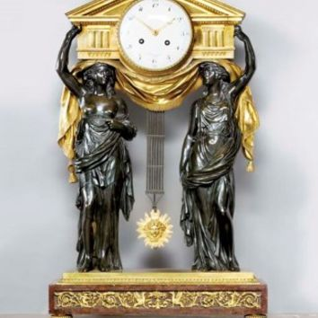 A Louis-Philippe Rouge Griotte marble, gilt- and patinated-bronze mantel clock, CIRCA 1840