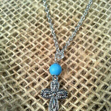 Cowgirl cross charm necklace with turquoise colored wire wrapped bead with lobster claw clasp