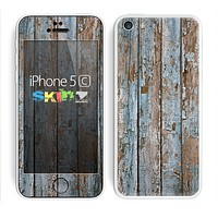 The Wood Planks with Peeled Blue Paint Skin for the Apple iPhone 5c