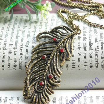 Pretty retro copper bird feather with red by toofashion2010