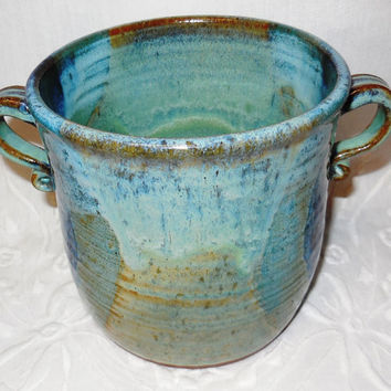 Hand thrown pottery wine chiller or vase in blue-green glazes on terra red clay