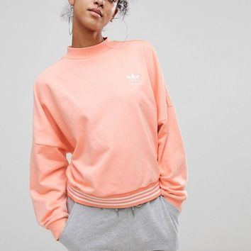 adidas Originals X Pharrell Williams Hu Coral Sweatshirt at asos.com