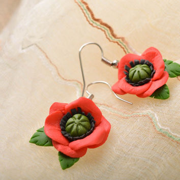 Handmade female big red and green flower earrings made of cold porcelain