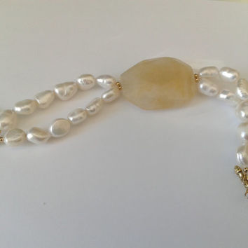 handmade  bracelet of two rows  white baroque pearls, and a yellow quartz faceted nuggets