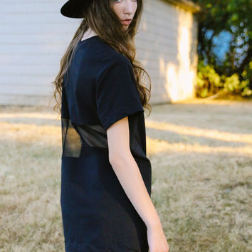 Slice - Minimal black sweatshirt tunic with sheer back insert