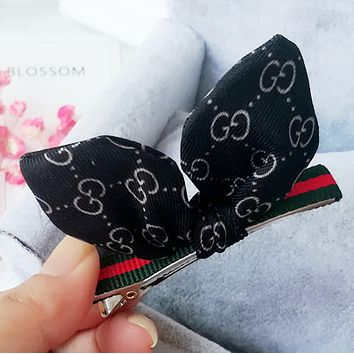 GUCCI G word fabric rabbit ears bangs red and green striped duckbill clip hairpin Mysterious black only