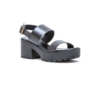 Featuring leatherette upper, open toe, slingback strap with adjustable buckle closure, platform and chunky heel with lug sole, stitching detail, and lightly padded insole.