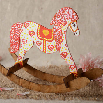 Small handmade painted plywood toy rocking horse for children