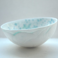 Decorative stoneware fine bone china bowl with a unique texture and glossy interior with blue speckles
