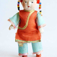 Antique Chinese Infant Baby Doll All Porcelain Bisque Toy Pin Jointed Arms Legs Hand Painted Silk Pajama Glass Beads Woven Straw Head Dress