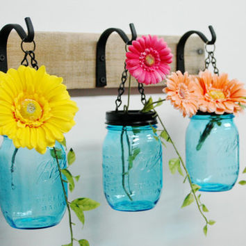 Hanging Blue Mason Jars Wall Decor mounted to recycled wood board with wrought iron hooks
