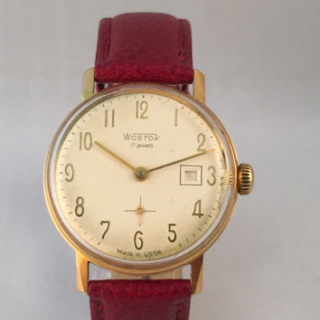 USSR Soviet Russian men's VOSTOK watch ,17jewels movement with date on the dial, great Vintage watch, new leather band.
